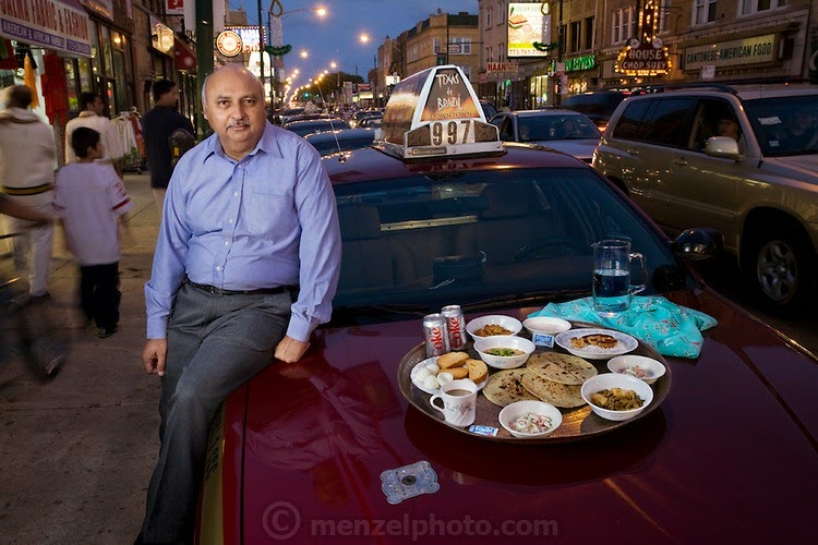"Din Memon, a Chicago taxi driver, with his typical day's worth of food arranged on the hood of his leased cab on Devon Avenue in Chicago, Illinois. (From the book What I Eat: Around the World in 80 Diets.) The caloric value of his day's worth of food in the month of September was 2,000 kcals. He is 59 years of age; 5 feet, 7 inches tall; and 240 pounds. Din came to the United States as a young man in search of freedom and opportunity and remains pleased with what he found. He has lived in Chicago for 25 years and has been driving a cab for the past two decades, five to six days a week, 10 hours a day. He knows where all of the best Indian and Pakistani restaurants are throughout Chicago, but prefers his wife's home cooking above all. His favorites? ""Kebabs, chicken tika, or biryani—spicy food,"" he says. Tika is dry-roasted marinated meat, and biryani is a rice dish with meat, fish, or vegetables that is highly seasoned with saffron or turmeric. MODEL RELEASED."