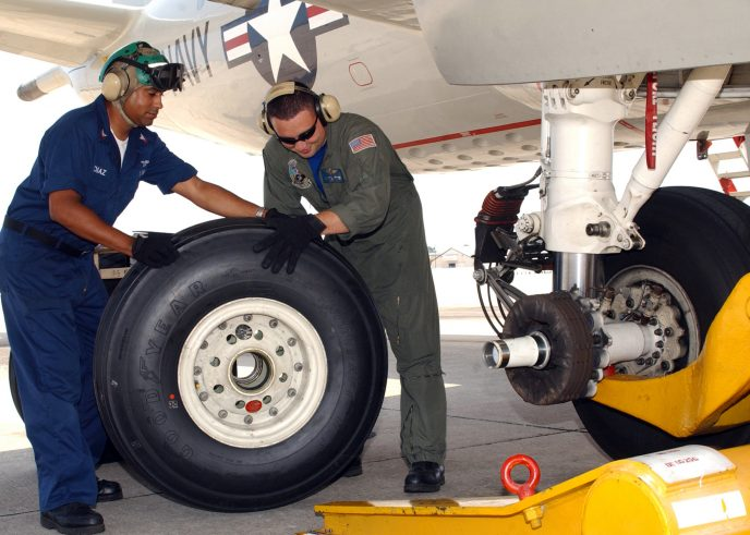 050810-N-8544C-008 Jacksonville, Fla. (Aug. 10, 2005) - Aviation Structural Mechanic 1st Class Anthony Versage, right, and Aviation Structural Mechanic 2nd Class Ramon Diaz replace a main landing gear tire on one of their squadronÕs P-3C Orion aircraft. Versage and Diaz are assigned to the ÒMad FoxesÓ of Patrol Squadron Five (VP-5). U.S. Navy photo by Photographer's Mate 2nd Class Susan Cornell (RELEASED)