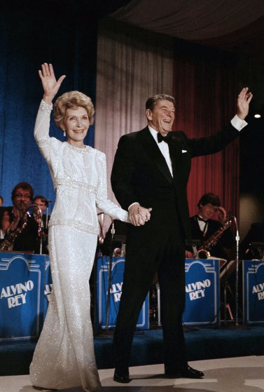President Ronald Reagan and Mrs Nancy Reagan arrive at the inaugural ball in the Washington Hilton on Jan. 21, 1985. (AP Photo/Ira Schwarz)